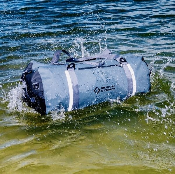 North Storm Waterproof Duffel bag floating on tweed river in NSW. Waterproof roll top duffel bag is super tough and waterproof. It can also handle a quick submersion or dunk.