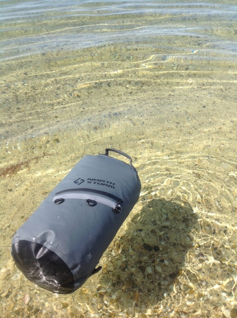 North Storm 20 Litre Dry Bag floating on crystal clear waters in South Australia. Very useful bag for keeping your gear dry while your on or near the water.