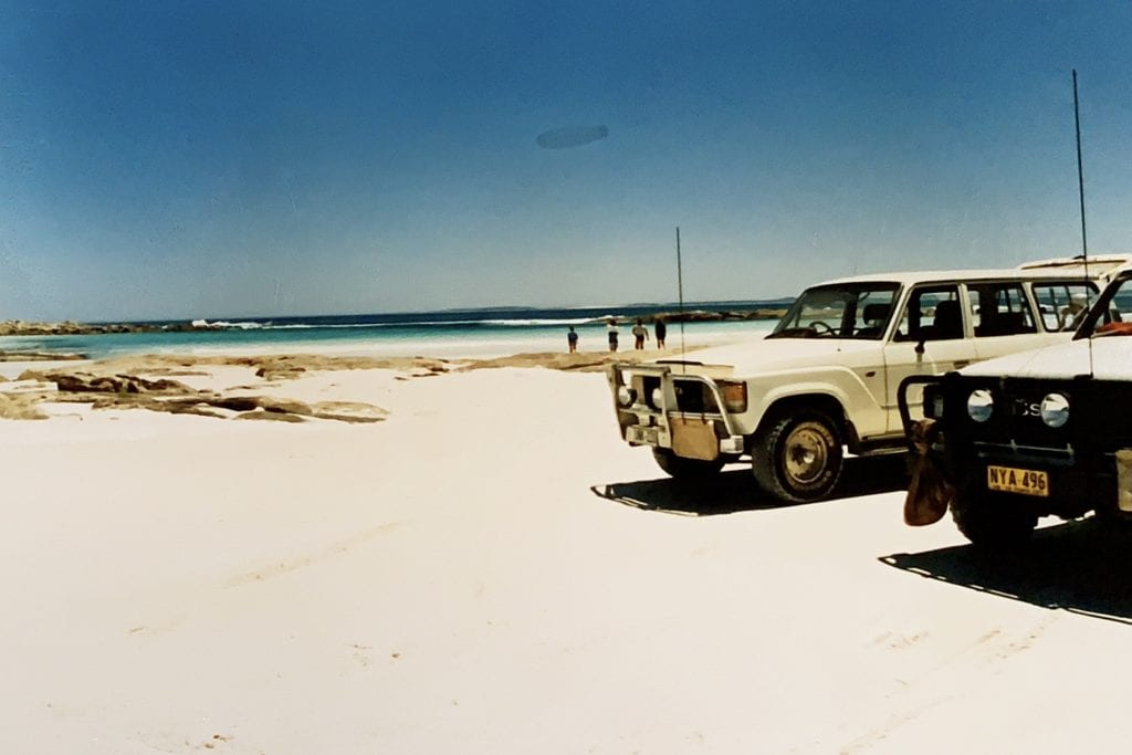 two for wheel drives parked on sandy white beach at Cape Arid in Western Australia. This was part of the journey or destination