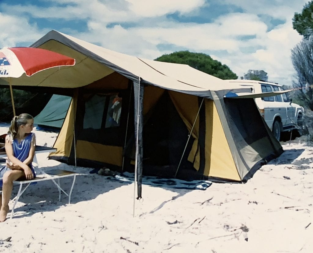 Photo of a girl sitting in front of a tent on very beautiful white sand on Western Australia's Israelite Bay