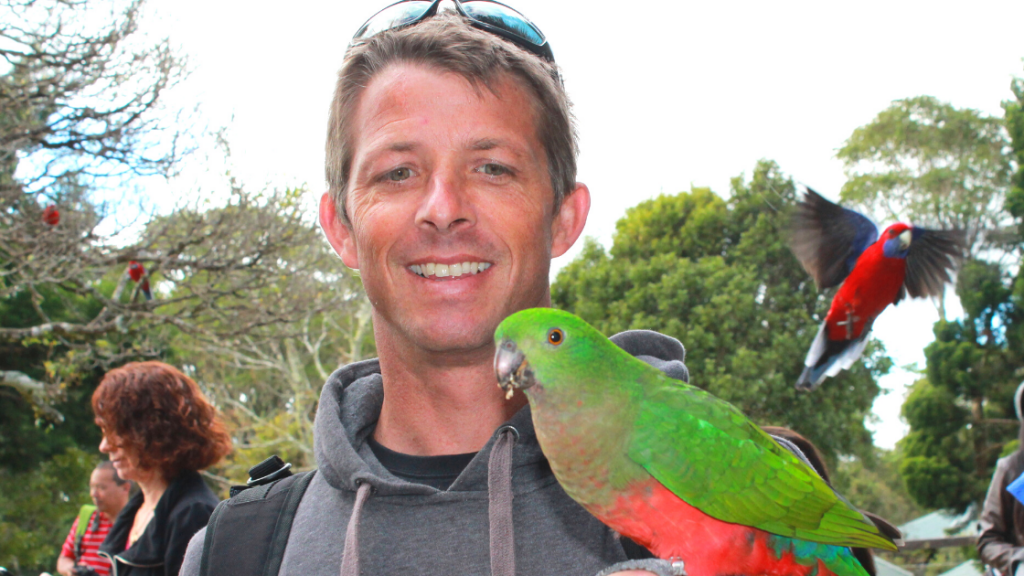 Marc with a King Parrot at OReillys Tree Top Walk Photo by North Storm Waterproof Bags