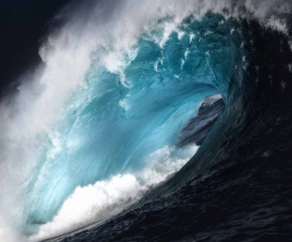 Photo of a huge barrel of a wave. It has a very heavy lip over hanging. Too big to surf! North Storm waterproof bag ambassador
