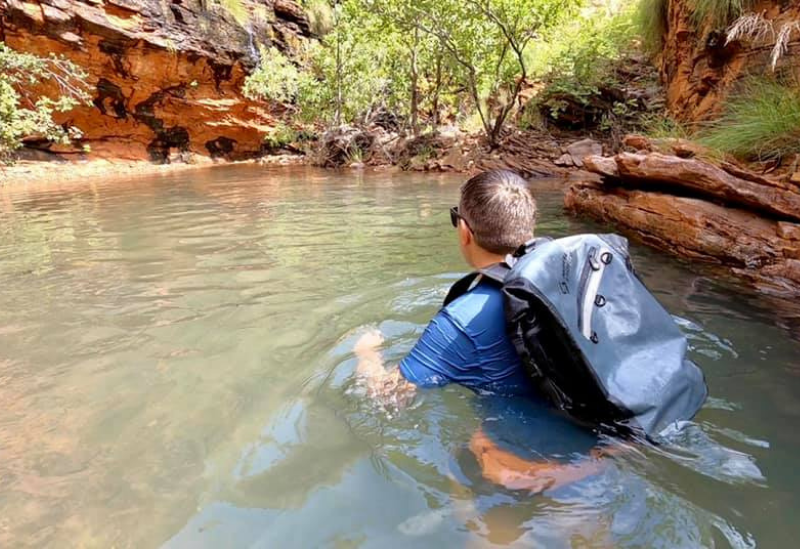 Big Oz Explorers Chris swimming with his North Storm waterproof backpack